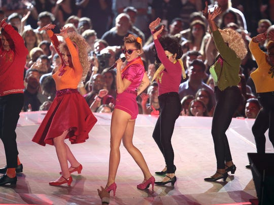 """Miley Cyrus performs """"Younger Now"""" at the MTV Video Music Awards at The Forum on Sunday, Aug. 27, 2017, in Inglewood, Calif."""