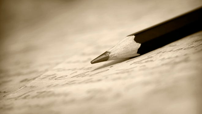 pencil on a letter, letter to the editor