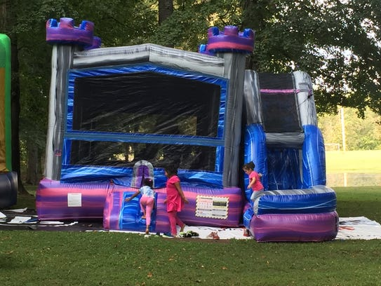 Kids played on bounce houses at the Austin's Journey