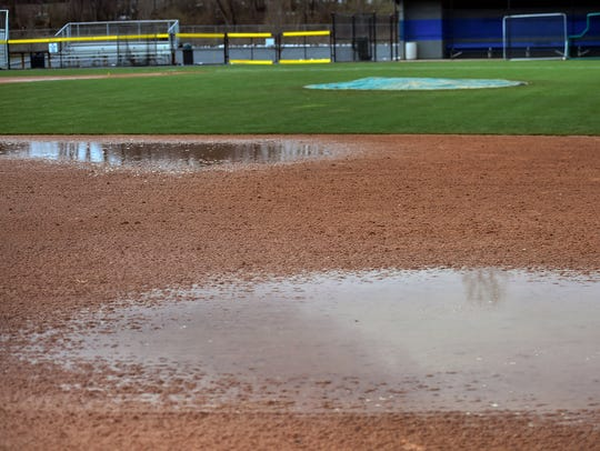 Puddles are visible Monday, April 2, 2018 at the Trojans baseball field at Greene Township Park. The spring season opened with snow and rain that is delaying the starts of seasons in the area.