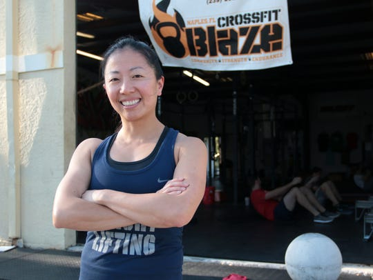 Janet Chow poses for a portrait in front of Crossfit Blaze in North Naples on Thursday, March 29, 2018. Chow, along with Estero resident Janine Giovinazzi, will compete at the National Masters Weightlifting Championship in Buffalo, New York from April 5-7.