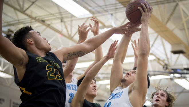Palmetto's Alex Rodreguez (20) and West Linn's Keishon Dawkins (23) battle for the rebound during their game at the King of the Bluegrass Holiday Classic in Fairdale, Wednesday, Dec. 13, 2017