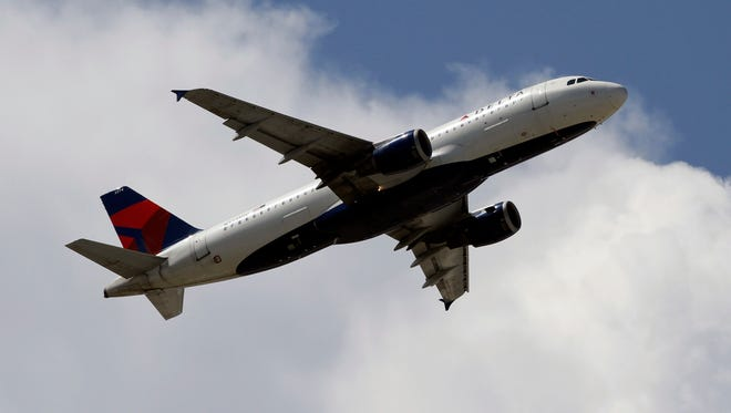 A Delta Air Lines plane takes off from Miami International Airport.