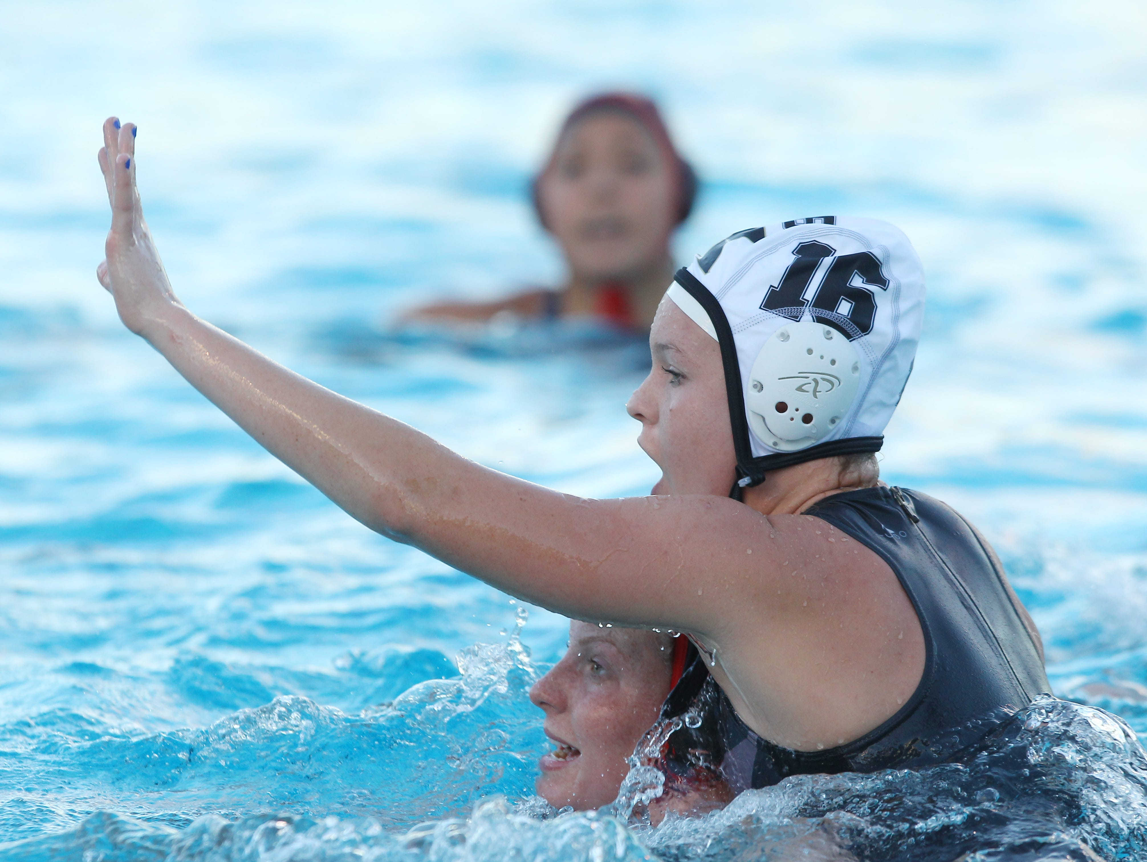 Palm Desert High School player, at bottom, is defended by Xavier Prep's #16 during their match at Palm Desert High School.