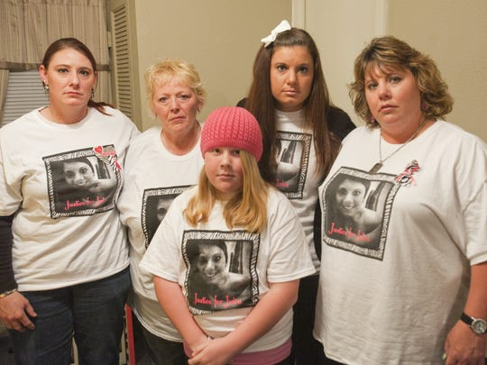 Julia Niswender's aunt, Carrie Niswender, from left, grandmother Rose Niswender, sister Madison Turnquist, twin sister Jennifer Niswender,  and mother Kim Turnquist, talk  April 9, 2013, about the loss of the Eastern Michigan University student who was found dead in her apartment.
