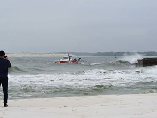 A coal barge is grounded on a sandbar near Fort Pickens