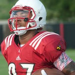 University of Louisville Cardinals wide receiver Jaylen Smith carries the ball at a University of Louisville football practice. 08 Aug 2015