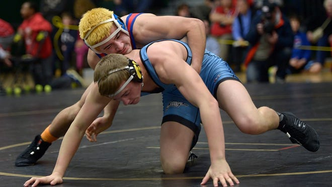 Fairport's Anthony Bell, top, defeats Greece's Justin Harter in the finals of the 152-pound weight class during the Section V Class AA Wrestling Championships at Rush-Henrietta High School on Saturday, Feb. 7.