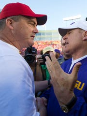 Second-year Badgers head coach Paul Chryst greets LSU Tigers head coach Les Miles following Wisconsin's 16-14 win on Labor Day weekend at Lambeau Field. Chryst, a former Wisconsin QB and assistant, returned to his alma mater as head coach in 2015.