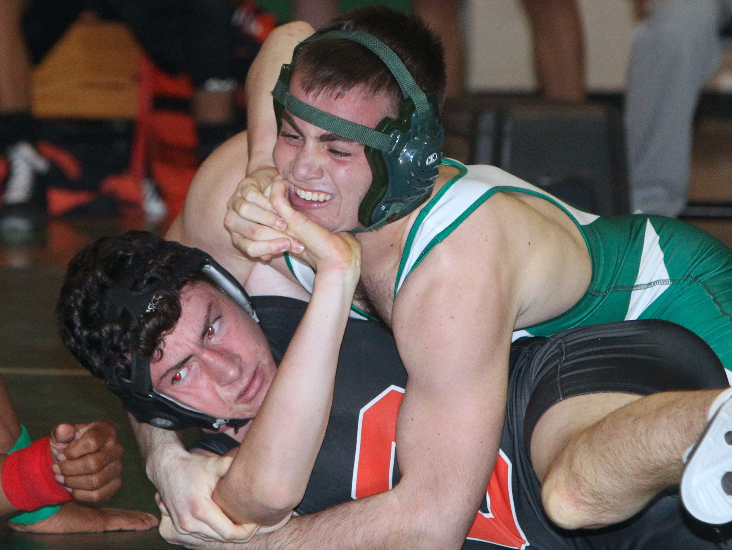Pleasantville's Doug Crocitto, top, pinned Croton's Nathan Parker in the 145-pound final at the Section 1 Dual Meet Championships Division 2 quad meet at Irvington Dec. 1, 2015.