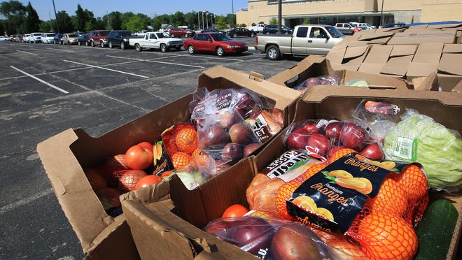 The USDA Farmers to Families food boxes wait to be distributed to Reno County residents during the USD 308 Summer Feeding Program on Tuesday in the east parking lot of the Sports Arena.