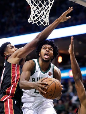 Bucks guard Sterling Brown eludes Heat center Hassan Whiteside.