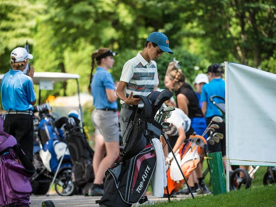 Groups of golfers wait to tee off during the York County