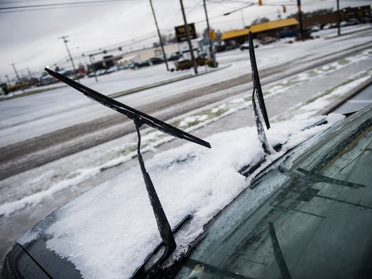 A car's windshield wipers are lifted up to protect them from freezing in a parking lot in North Hanover on Dec. 17, 2016.
