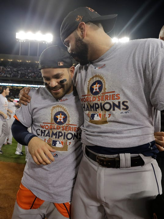Houston Astros' Jose Altuve and Marwin Gonzalez celebrate after Game 7 of baseball's World Series against the Los Angeles Dodgers Wednesday, Nov. 1, 2017, in Los Angeles. The Astros won 5-1 to win the series 4-3. (AP Photo/David J. Phillip)