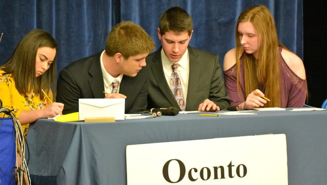 At a match at Oconto High School in February, Oconto High School Hi-Q team members work together to solve a math problem during the first half of competition. Left to right are Morgan Durand, Lucas Ruechel, Balin Welch and Mara Allen.