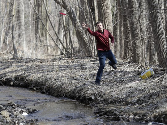 Franklyn Nytes of Appleton fires his disc over a creek