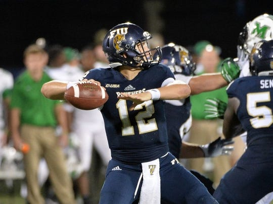 FIU Golden Panthers quarterback Alex McGough (12) throws against Marshall Thundering Herd during the second half at FIU Stadium.