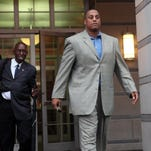 FILE - In this Sept. 23, 2011, file photo, former NBA player and University of Connecticut star Tate George leaves federal court in Newark, N.J. Tate George is in federal court in New Jersey for a sentencing hearing on fraud charges connected to an alleged Ponzi scheme. Wednesday's, Jan. 20, 2016, hearing in Trenton is a continuation of hearings that began in December.  (Leslie Barbaro/The Record of Bergen County via AP,  File) ONLINE OUT; MAGS OUT; TV OUT; INTERNET OUT;  NO ARCHIVING; MANDATORY CREDIT
