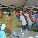 During a previous Town of Washington Catfish Festival, visiting queens gathered for a group photo. More rain in the forecast has caused the town to reschedule this weekend's festival until October 1-4, 2015.
