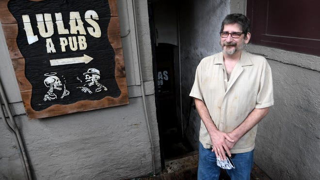 Wilmington artist Bryan Jacobs outside the bar Lula's, which he's owned since 2010.