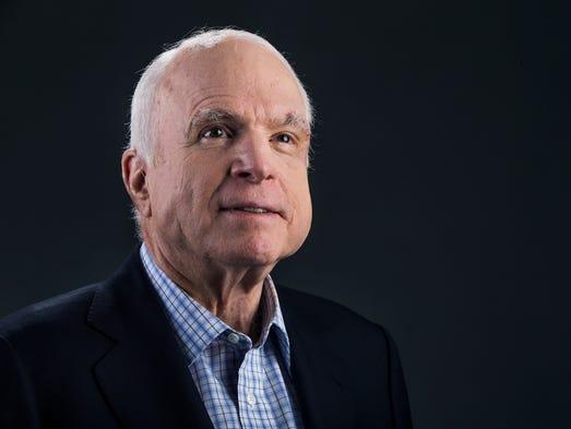 Sen. John McCain poses at the Republic Media building