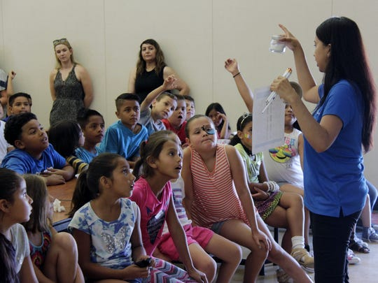 Brenda Zambrano, TRMC promotora de salud, shows students how much sugar is in some of their favorite foods during a nutrition presentation at Heritage Elementary School in Tulare on Thursday.