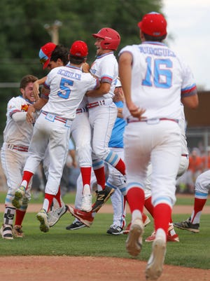 D-BAT Elite 17U celebrates after beating the Colton Nighthawks on Friday in Game 1 of the Connie Mack World Series at Ricketts Park in Farmington.
