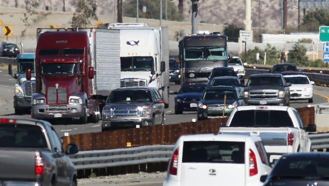 Traffic moves along Interstate 10 near Palm Springs. AAA predicts 3.03 million Southern Californians will travel by car this Thanksgiving week.