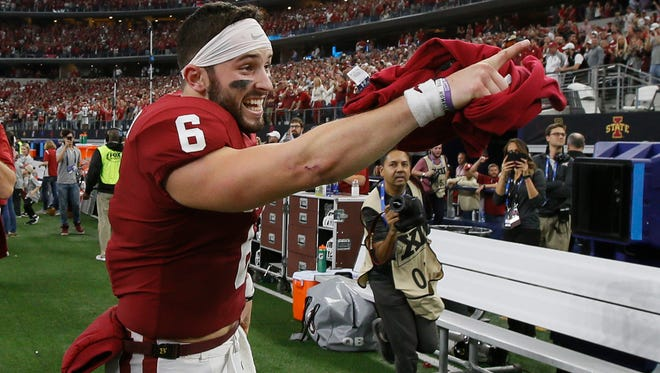 Oklahoma Sooners quarterback Baker Mayfield (6) points to the stands after winning the Big 12 Championship game against the TCU Horned Frogs.