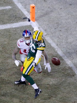 Green Bay Packers cornerback LaDarius Gunter (36) breaks up a pass to New York Giants wide receiver Odell Beckham (13)  during the 2nd quarter at Lambeau Field.