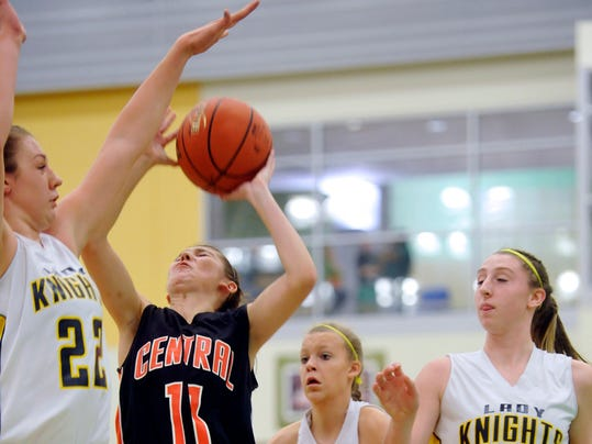 Central York's Alexis Balanda (11) tries to get a shot off against Eastern York's Elizabeth Myers during the Donnie Swartz Memorial Classic on Saturday night. (Daily Record/Sunday News -- Chris Dunn)