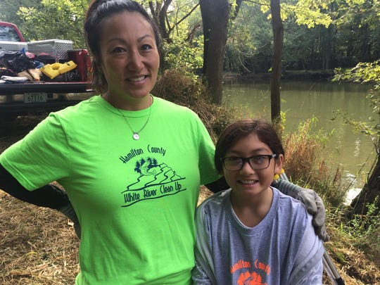 Kate Lustig and her daughter, Kaiya, picked up trash in Carmel on Saturday, Sept. 12, 2015, during the annual White River Cleanup.