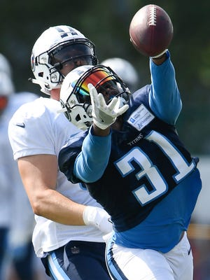 Titans safety Kevin Byard (31) lets an interception slip through his grasp during training camp practice Thursday, Aug. 3, 2017, at Saint Thomas Sports Park.