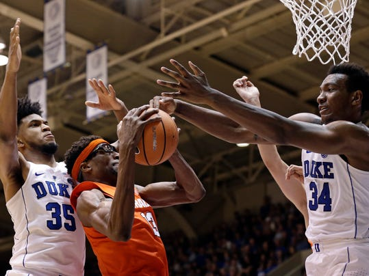 Duke's Marvin Bagley III (35) and Wendell Carter Jr. (34) block Syracuse's Paschal Chukwu during the second half of an NCAA college basketball game in Durham, N.C., Saturday, Feb. 24, 2018. (AP Photo/Gerry Broome)