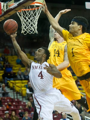 New Mexico State guard Ian Baker (4) is the lone senior for the Aggies this season. NMSU begins the 2016-17 season Nov. 11 against Arizona Christian at the Pan American Center.