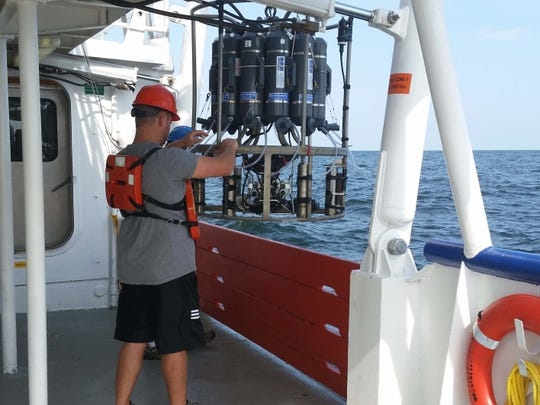 Scientists deploy a sensor to detect oxygen levels in the water in the Gulf of Mexico in 2015.
