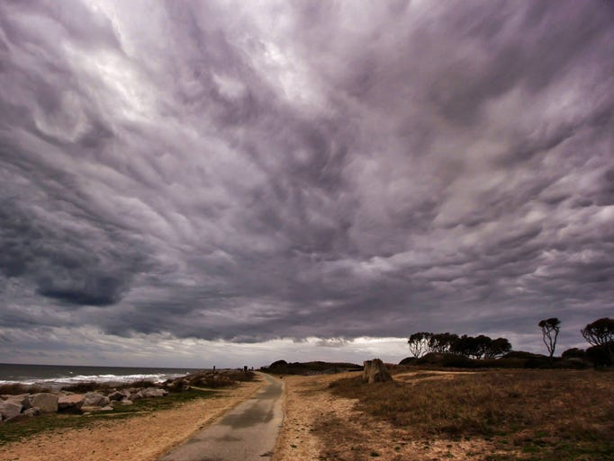 A photographer's wide-angle lens captures an ominous