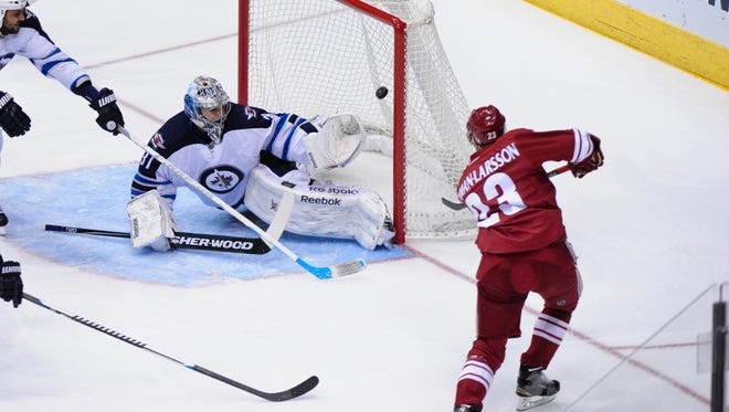 Arizona Coyotes defenseman Oliver Ekman-Larsson (23) scores a power play goal on Winnipeg Jets goalie Ondrej Pavelec (31) during the first period at Gila River Arena in Glendale on Jan. 8.
