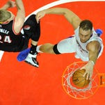 Apr 17, 2016; Los Angeles, CA, USA; Los Angeles Clippers forward Blake Griffin (32) dunks against Portland Trail Blazers center Mason Plumlee (24) during the second half in game one of the first round of the NBA Playoffs at Staples Center. Mandatory Credit: Richard Mackson-USA TODAY Sports