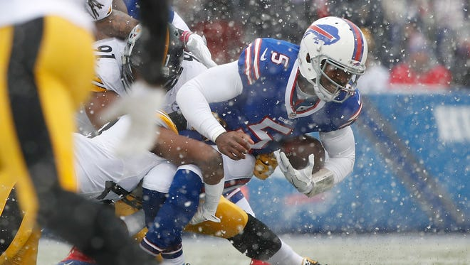 Dec 11, 2016; Orchard Park, NY, USA; Buffalo Bills quarterback Tyrod Taylor (5) is sacked by Pittsburgh Steelers safety Sean Davis (28) and defensive end Stephon Tuitt (91) during the first quarter at New Era Field. Mandatory Credit: Kevin Hoffman-USA TODAY Sports