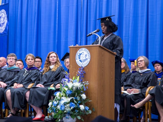 Bridgett Wilder delivers a commencement address last month at Mount Mary University. The audience gasped when she told them she was widowed at age 36 with nine children at home.