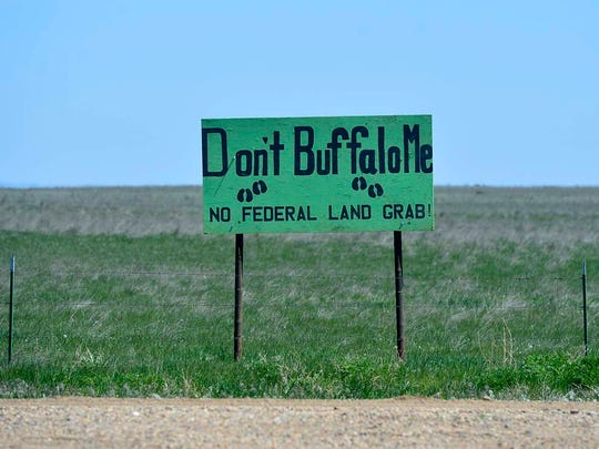 Signs opposing bison are posted along county roads enroute to the American Prairie Reserve's bison range.