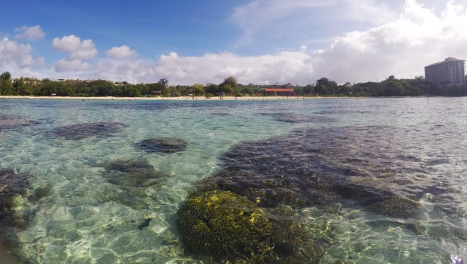 The warming waters around Guam are stressing and killing the coral barrier ringing the island. Seen here is Ypao Beach, a popular destination for tourists and locals alike to snorkel the coral reef.