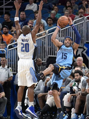 Memphis Grizzlies guard Vince Carter (15) saves the ball from going out of bounds in front of Orlando Magic guard Jodie Meeks (20) during the first half of an NBA basketball game in Orlando, Fla., Monday, Dec. 26, 2016. (AP Photo/Phelan M. Ebenhack)