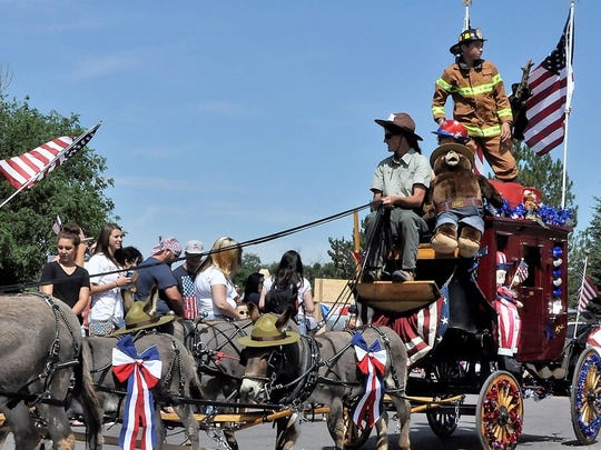 Smokey Bear is a passenger on this U.S. Forest Service parade entry during last year's Smokey Bear Independence Day Parade.