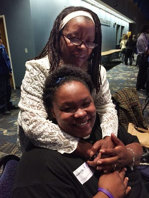 Jeanette Perkins (seated) has found support from many people, including her mom, Barbara Williams.