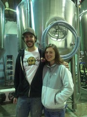 Eli Facchinei and Katie Labine are shown at Tonewood Brewing in Oaklyn. Tonewood has begun offering cans of select beers.