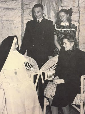 The Ramonaitis, Joseph, Bernadetta and Ann, meet with a nun from Catholic Services in 1949 upon their arrival to the U.S.