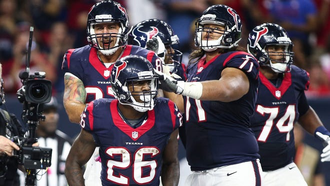 Houston Texans running back Lamar Miller (26) celebrates with teammates after scoring a touchdown during the third quarter against the Indianapolis Colts at NRG Stadium.